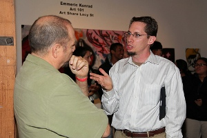 Mark Regnerus chats with a guest at the reception